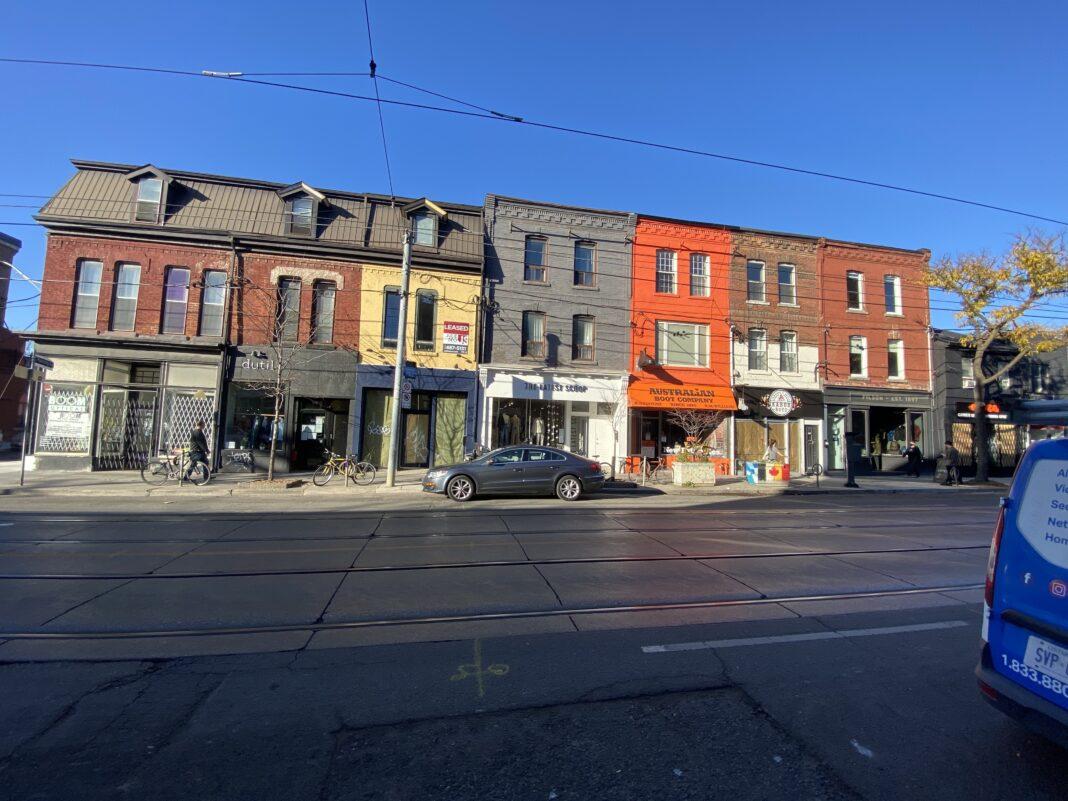 Row of small retailers on Toronto's Queen Street West. Photo: Dustin Fuhs