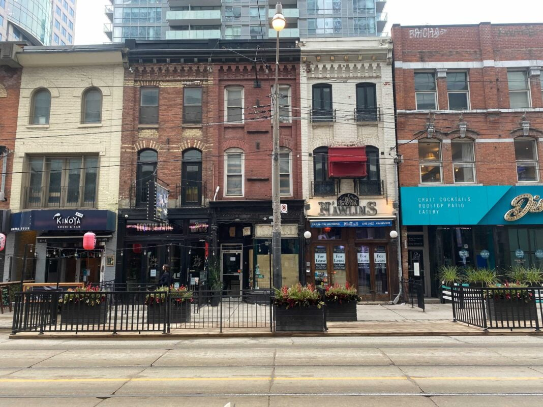 Row of small businesses on King Street West in Toronto. Photo: Dustin Fuhs