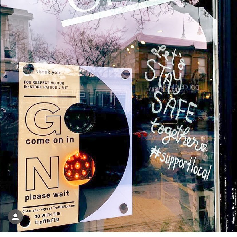 TraffikFlo system on front door of store also promoting #supportlocal. Photo: TraffikFlo Facebook