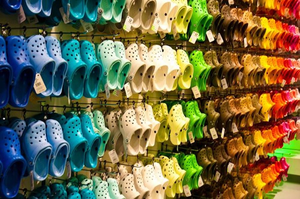 Interior of Crocs store showcasing a variety of colours. Photo: Crocs