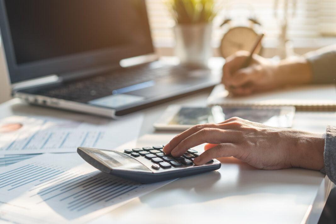 Businessman calculating business balance