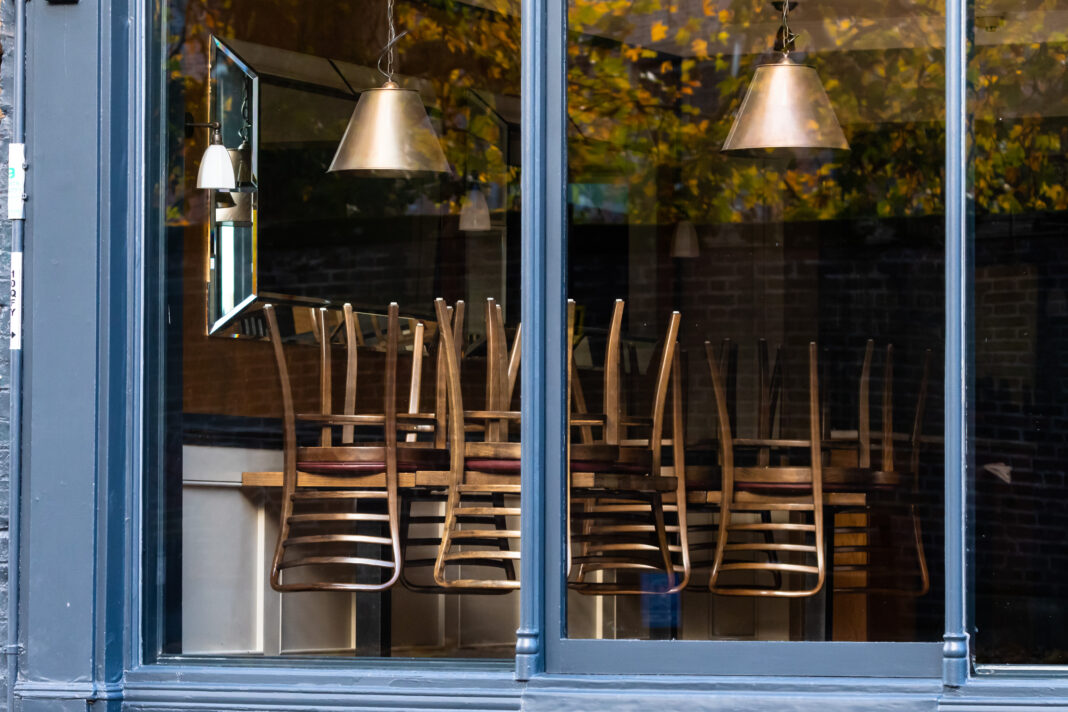 Window of an empty restaurant forced to close amid COVID-19 pandemic