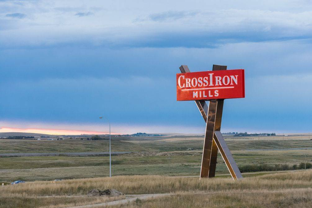 CrossIron Mills sign next to Highway 2 freeway connecting Calgary and Edmonton.