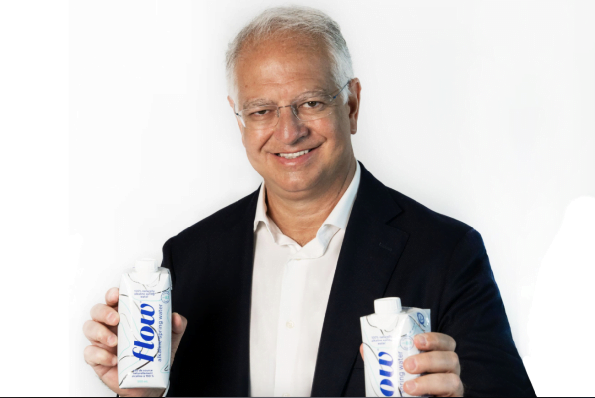 Mr. Maurizio Patarnello holding Flow products