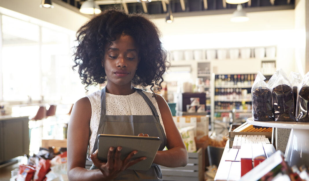 Retail worker using smart device