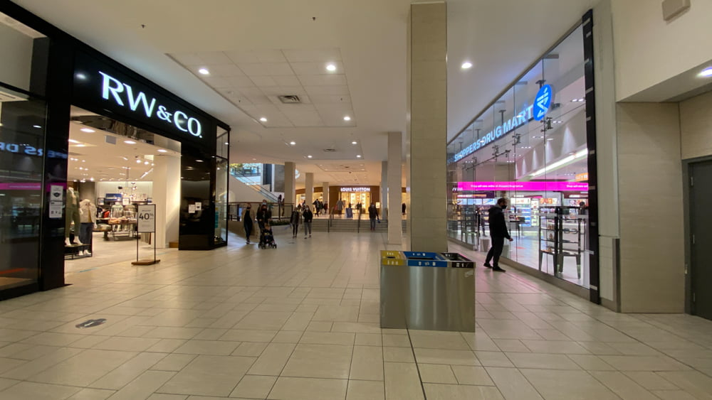 Between RW&Co. and Shoppers before entering the North-West End on CF Chinook Centre's Lower Level