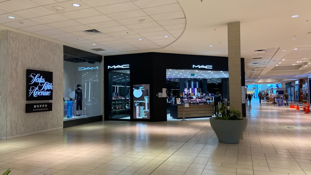 MAC Cosmetics next to Saks Fifth Avenue on the lower level of CF Chinook Centre
