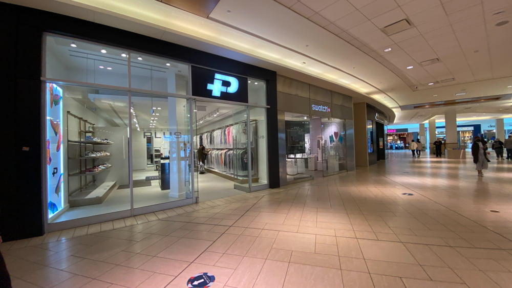 Plus and Swatch on lower level in CF Chinook Centre