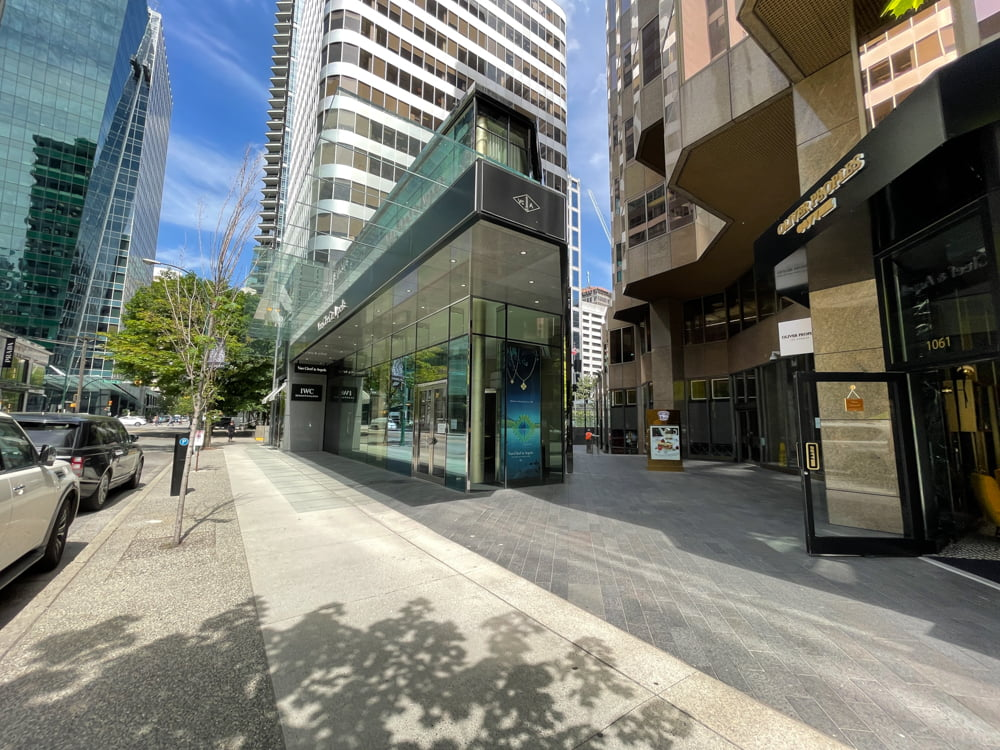 Sidewalk view on Alberni Street passing Oliver Peoples, the passthru to TWG Tea Salon & Boutique and Van Cleef & Arpels