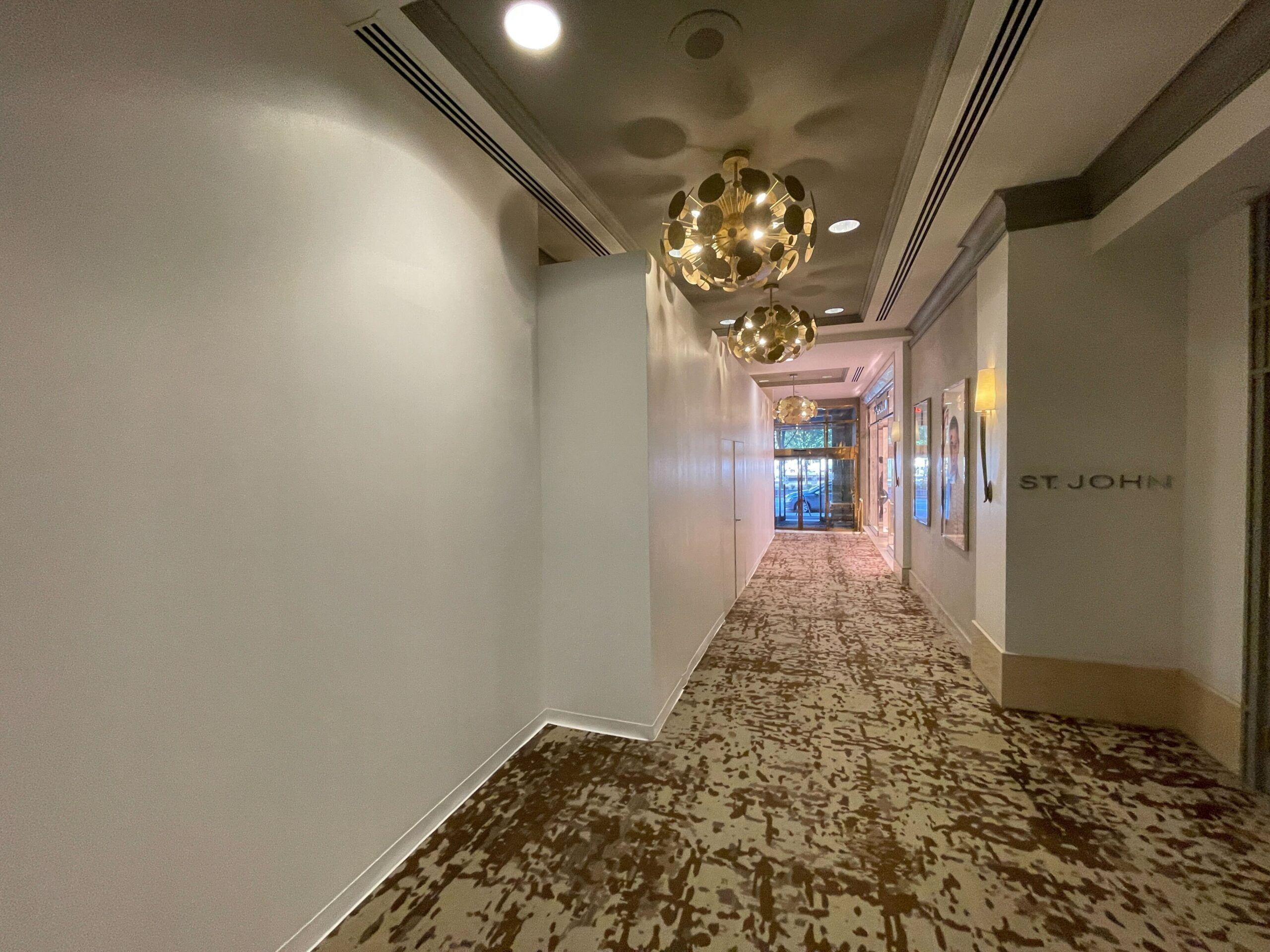 Former interior Gucci entrance with construction boarding erected at Fairmont Hotel Vancouver (September 2021)